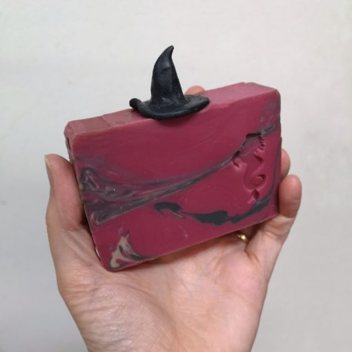 Witch soap being held in hand